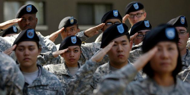 Soldiers from the U.S. Army's 2nd Infantry Division salute during the Combined Division activation ceremony at Camp Red Cloud