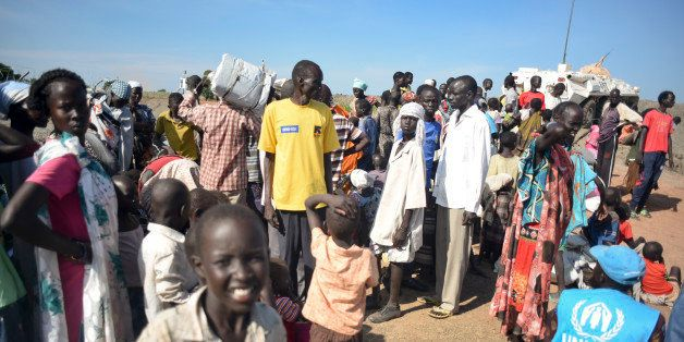 In this photo taken Monday, June 29, 2015, newly-arrived displaced people register to receive food and other aid at the UN ba
