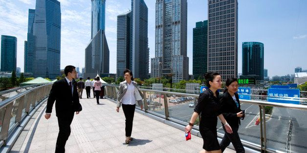 SHANGHAI, CHINA - MAY 24:  White-collars walk to their lunch break in Pudong business district in Shanghai, China, on May 24,