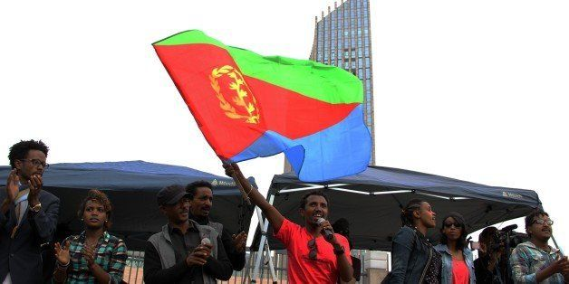 ADDIS ABABA, ETHIOPIA - JUNE 26: An Eritrean refugee waves an Eritrea flag during a demonstration in front of the African Uni