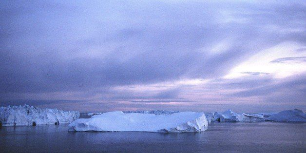 JACOBSHAVN BAY, GREENLAND - AUGUST 24: (ISRAEL OUT) Icebergs float in the Jacobshavn Bay on August 24, 2007 near the town of Ilulissat, Greenland. Scientists believe that Greenland, with its melting ice caps and disappearing glaciers, is an accurate thermometer of global warming. (Photo by Uriel Sinai/Getty Images)