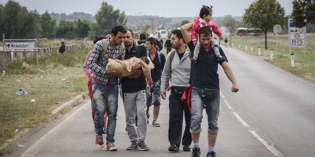 NICKELSDORF, AUSTRIA - SEPTEMBER 14 :  Refugees leaving Nickelsdorf walk towards Vienna on September 14, 2015. (Photo by Hasa