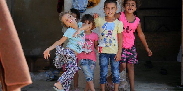 Syrian refugee children play at an unofficial refugee camp in the northern Lebanese city of Tripoli, north of the capital Bei