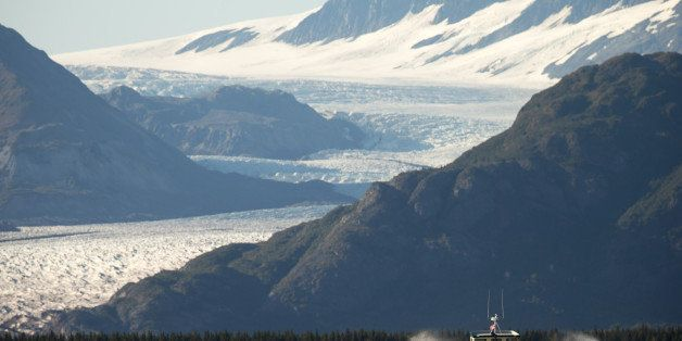 A boat carrying President Barack Obama makes its way to Bear Glacier, which has receded 1.8 miles in approximately 100 years