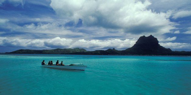 Tahiti, Boating Off The Coastline, Blue-Green Water. (Photo by Education Images/UIG via Getty Images)