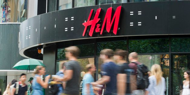 Frankfurt, Germany - August 14: People pass by a branch of H+M ( H&M, Hennes and Mauritz ) department store on August 14, 201