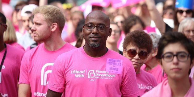 MANHATTAN, NEW YORK CITY, NEW YORK, UNITED STATES - 2015/09/29: Activists in pink shirts listen to speeches. Activists and di