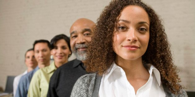 Group of business people standing in row, portrait
