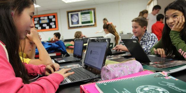 HOPKINTON, MA - SEPTEMBER 26: Students studying Earth Science at the Hopkinton Middle School on their Chromebooks. (Photo by