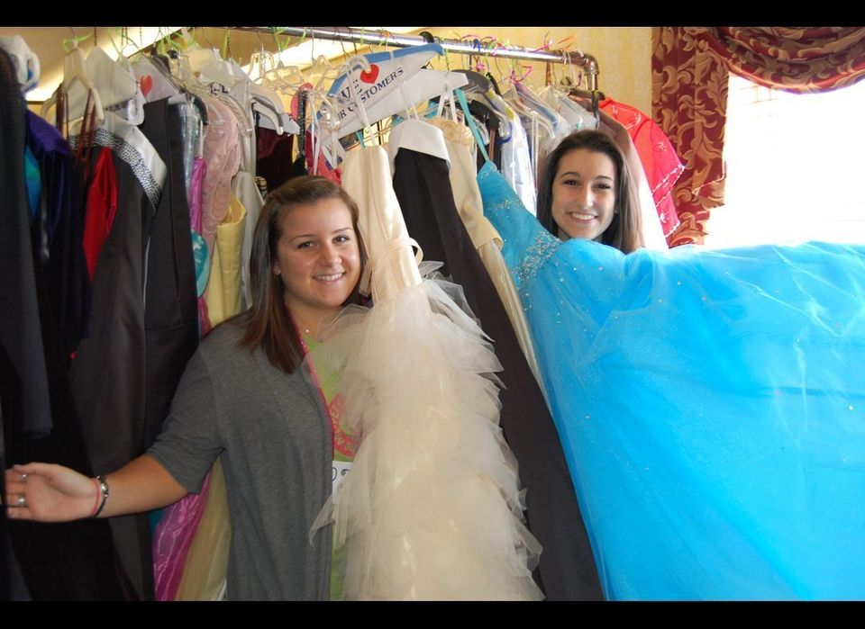 PJ and Justine an a sea of dresses at their PGOM Prom Boutique where they collected over 217 brand new and gently used dresse