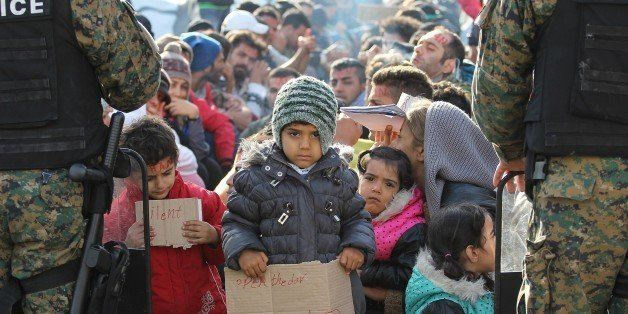 GEVGELIJA, MACEDONIA - NOVEMBER 24: Refugees stage a protest against governments' double standards over refugee admittance po