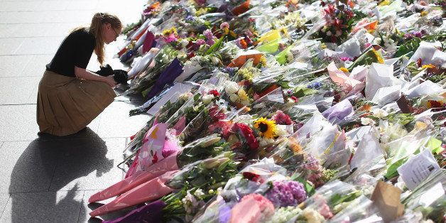 SYDNEY, AUSTRALIA - DECEMBER 17:  Flowers are left as a sign of respect at Martin Place on December 17, 2014 in Sydney, Austr