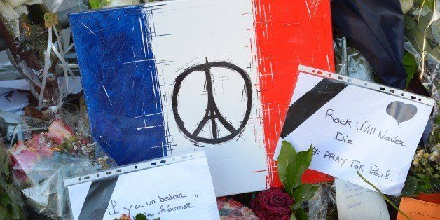 This photo taken on November 26, 2015 shows messages and artwork left at a makeshift memorial in front of the Bataclan concer
