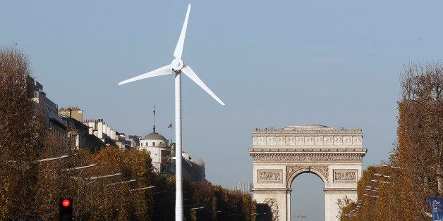 PARIS, FRANCE - NOVEMBER 26:  A wind turbine is installed to provide electricity for Christmas illuminations on the Champs-El