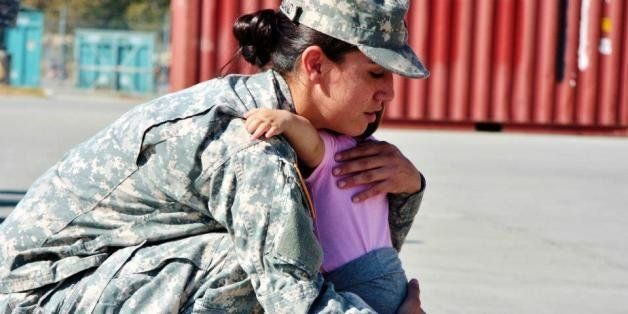 A Soldier and Mother embraces her daughter during the 125th Forward Support Company, 1st Battalion, 94th Field Artillery Regi