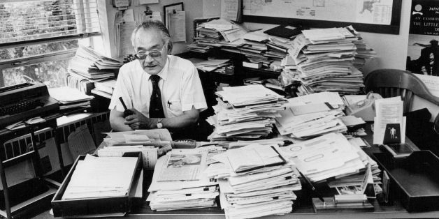 SEP 17 1981, SEP 20 1981, SEP 22 1981; Minoru Yasui sits behind office desk piled high with papers; *****he put in 2,185 hour