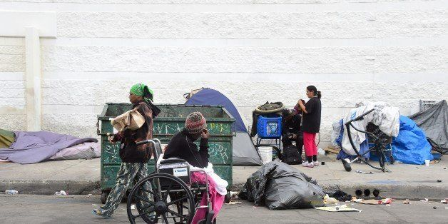 Homeless women prepare for another day and night on the street near Skid Row in Los Angeles, California on May 12, 2015. A re