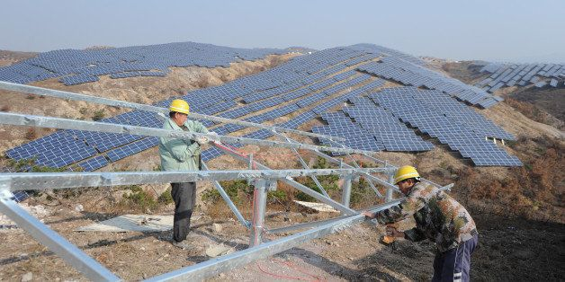 YANTAI, CHINA - NOVEMBER 17:  (CHINA OUT) Workers install polycrystalline silicon solar panels as terrestrial photovoltaic po