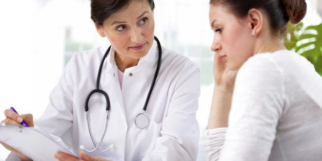 doctor explaining diagnosis to her female patientPlease see similar images here: