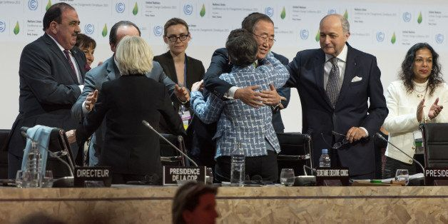 PARIS, FRANCE - 2015/12/12: Chief Ban Ki-Moon (C) hugs Executive Secretary of the United Nations Framework Convention on Clim