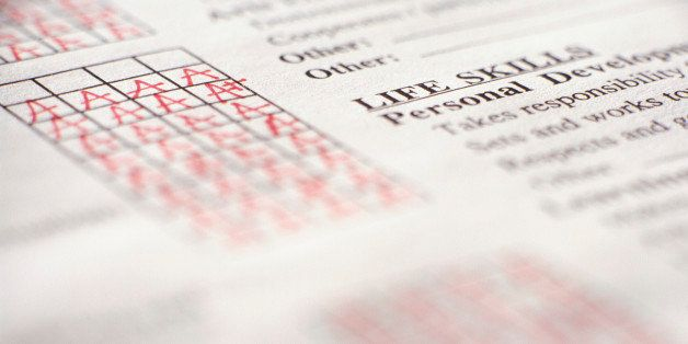 Report card filled in with red letters A, elevated view