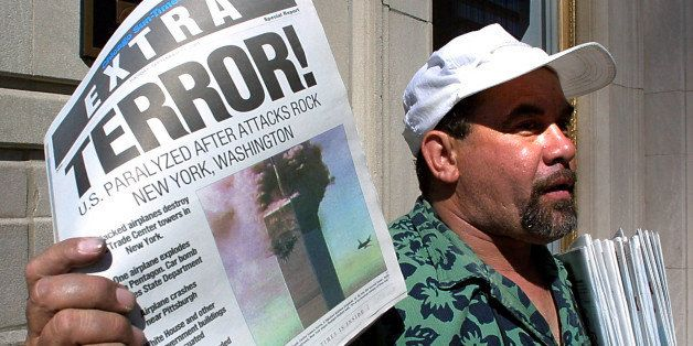Newspaper vendor Carlos Mercado sells the 'Extra' editon of the Chicago Sun-Times printed  11 September, 2001, after the terr