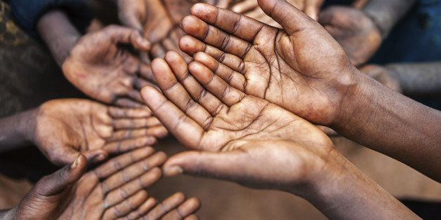 'Poor African children keeping their hands up - asking for help. Many African children suffer from poverty - 20%25 of Africaa
