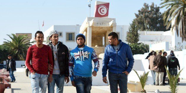 Tunisian graduates and unemployed youth walk on Mohamed Bouazizi square on December 14, 2015, in the impoverished central tow