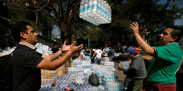Workers load humanitarian aid for Haiti at Haiti's embassy in Mexico City, Saturday, Jan. 16, 2010.  The International Red Cr