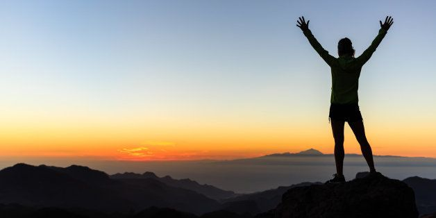 Woman successful hiking climbing silhouette in mountains, motivation and inspiration in beautiful sunset and ocean. Female hi