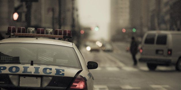 NYPD pulled over in New York City during light snow storm. Cinematic tones add to scene.