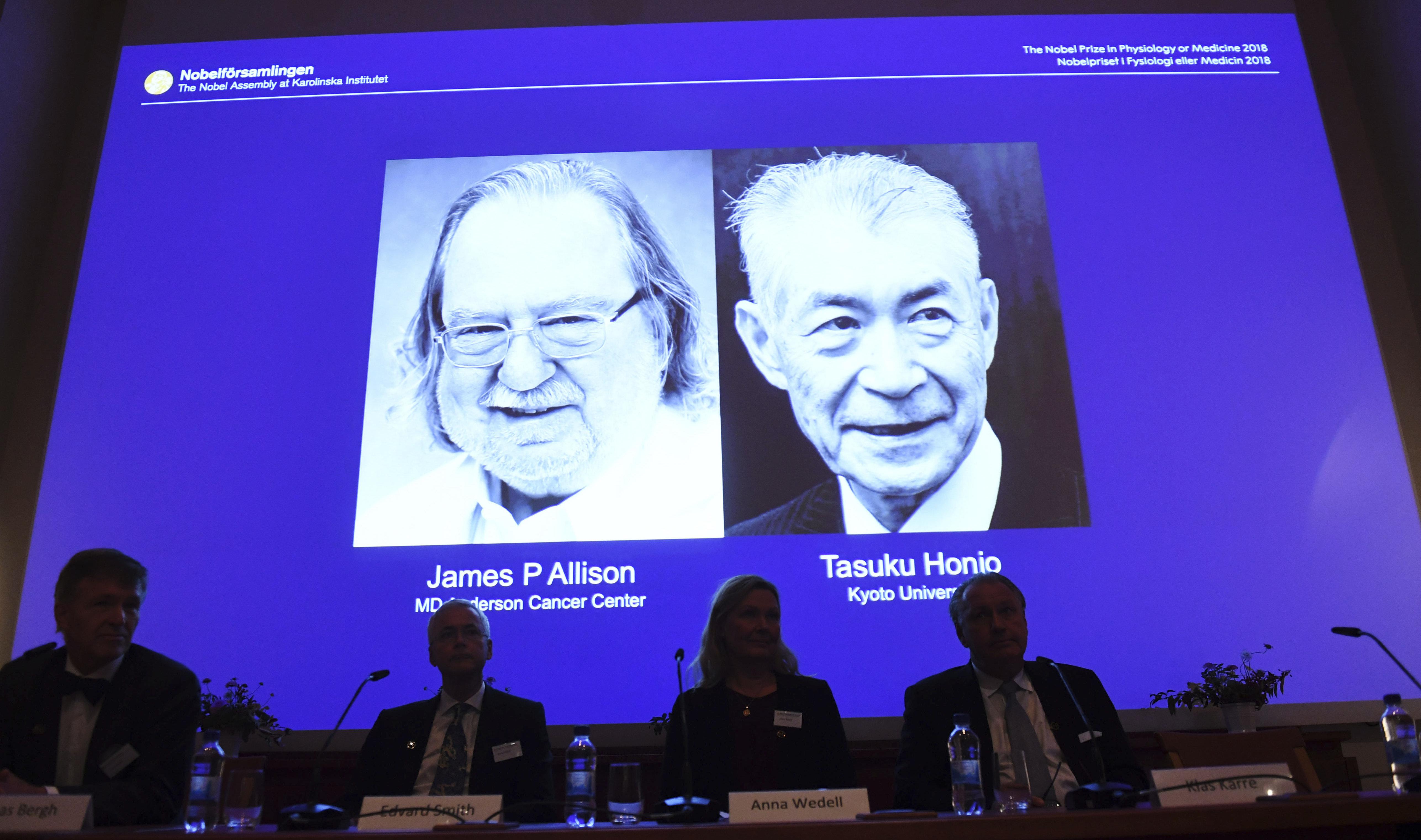 Nobel prize laureates James P. Allison, left, and Tasuku Honjo are shown during the presentation in Stockholm on Oct. 1.