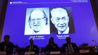 Nobel prize laureates James P Allison left and Tasuku Honjo are shown during the presentation in Stockholm on Oct 1