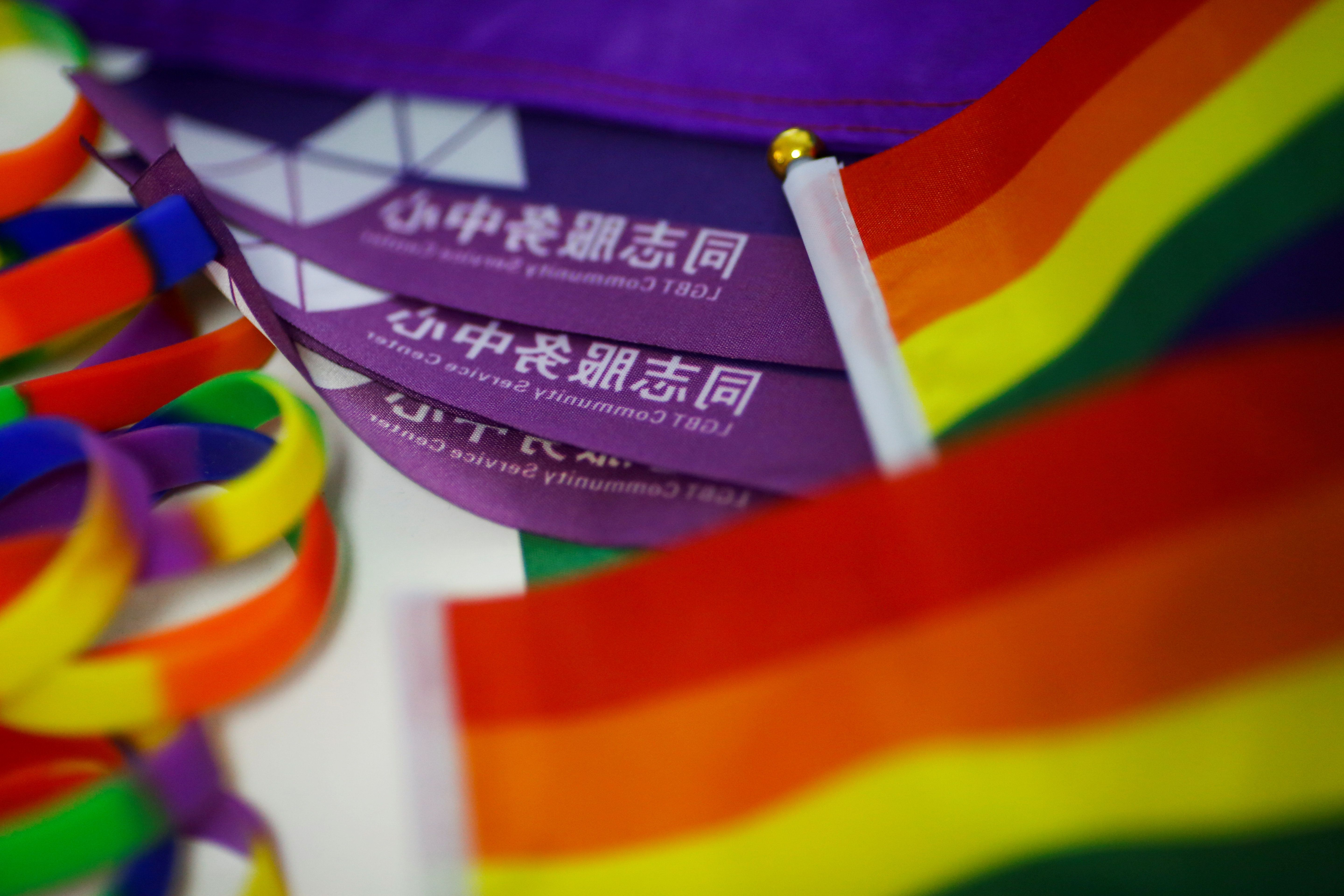 Rainbow flags lie on the desk of Liu Yifu, an organiser of a 5.17 km run to mark International Day Against Homophobia in Beijing, China, May 17, 2018. REUTERS/Thomas Peter