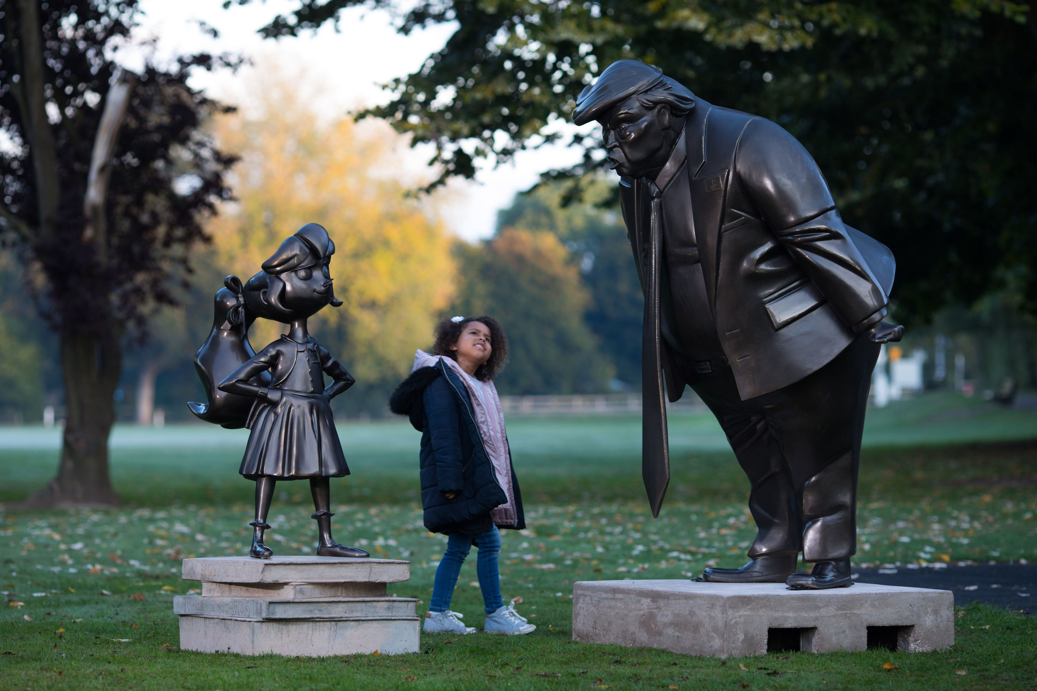 Amilie Bravington, 6, from High Wycome, takes a look at a statue of Roald Dahl's Matilda, unveiled in Great Missenden in Buck