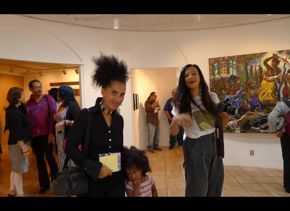 Curator Lili Bernard, Left Foreground, poses with Amitis Motevalli, Right Foreground, Director of the WIlliam Grant Still Art