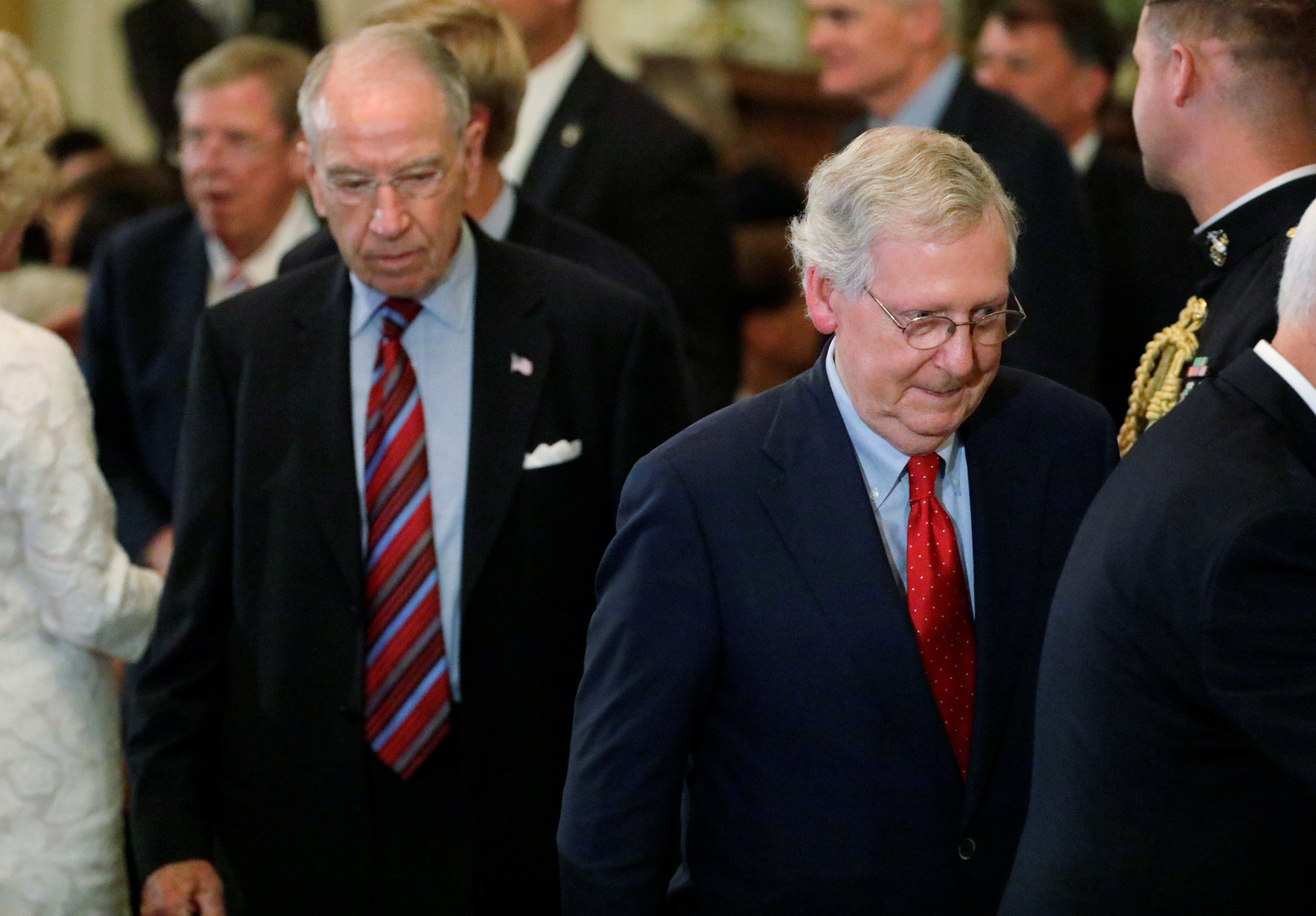 U.S. Senate Judiciary Committee Chairman Chuck Grassley and Senate Majority Leader Mitch McConnell arrive to watch President Donald Trump announce that Judge Brett Kavanaugh is his nominee for the U.S. Supreme Court in the East Room of the White House in Washington, U.S., July 9, 2018. Picture taken July 9, 2018.  REUTERS/Jim Bourg