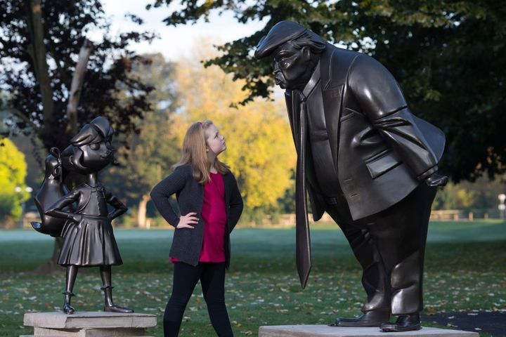 Mollie Sutton, eight, from Romford takes a look at a statue of Roald Dahl's Matilda.