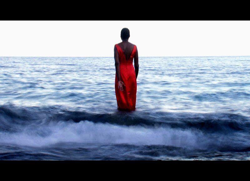 "Film still by Ali Hossaini from Paola Prestini's multimedia opera ""Oceanic Verses."" Performer ID: Helga Davis"