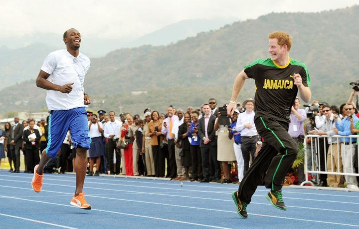 Prince Harry racing against Usain Bolt at the University of the West Indies in Jamaica in 2012.
