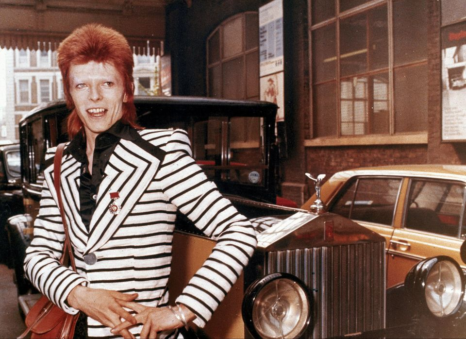 British rock singer David Bowie poses beside his Rolls Royce in May 1973.  Photo: PA