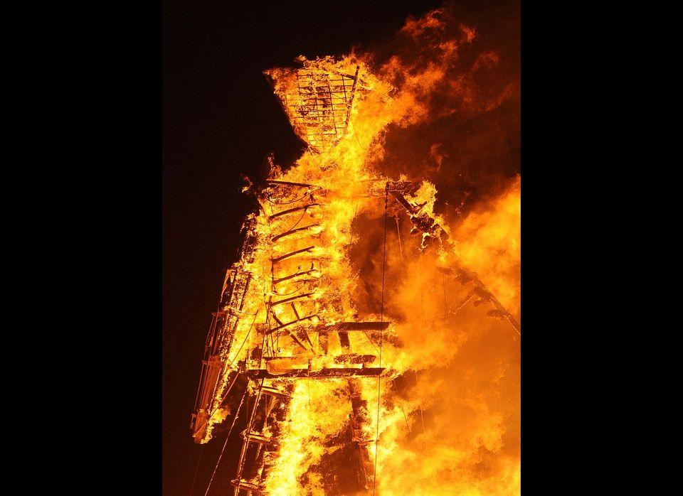 The Man burns on the playa at Burning Man on the Black Rock Desert near Gerlach, Nev. on Friday August 31, 2012. (AP Photo/An