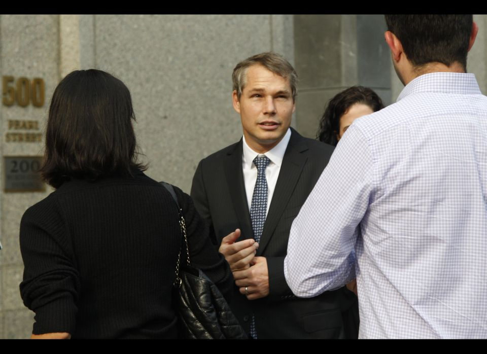 "Shepard Fairey, center, arrives at Manhattan Federal court, Friday, Sept. 7, 2012 in New York. The artist who created the ""HO"