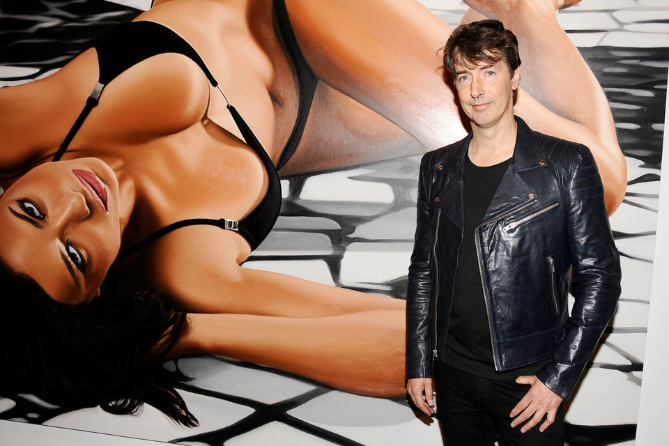Richard Phillips in front of his painting of Adriana Lima.