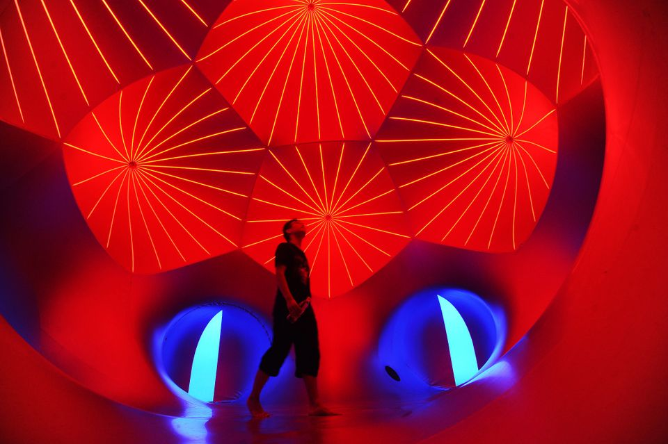 People walk inside the Miracoco Luminarium, an inflatable sculpture by British artist Alan Parkinson of Architects of Light,