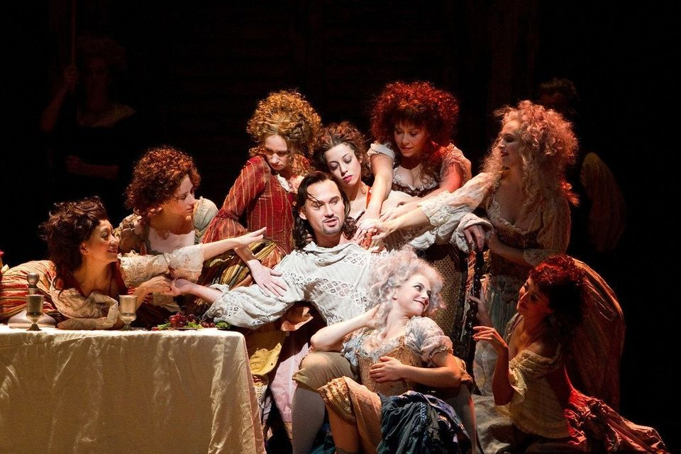 In this Oct. 3, 2011 photo released by the Metropolitan Opera, Mariusz Kwiecien, center, performs in the title role of Mozart