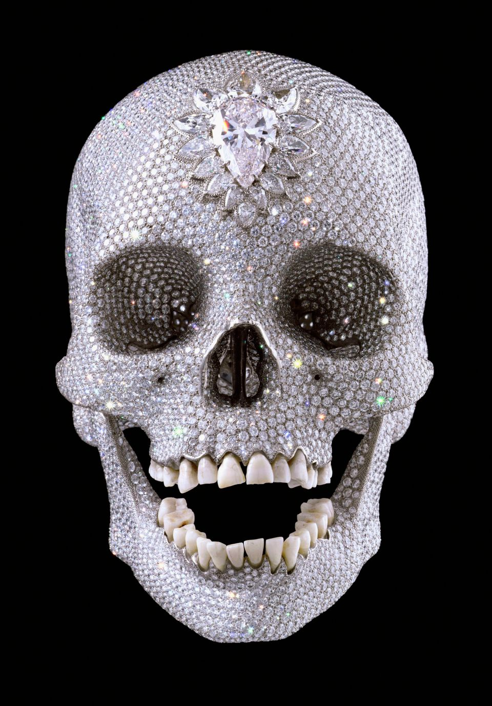 Artist Damien Hirst is well known for his affinity for human skulls. This particular skull is shown covered with 8,601 diamon