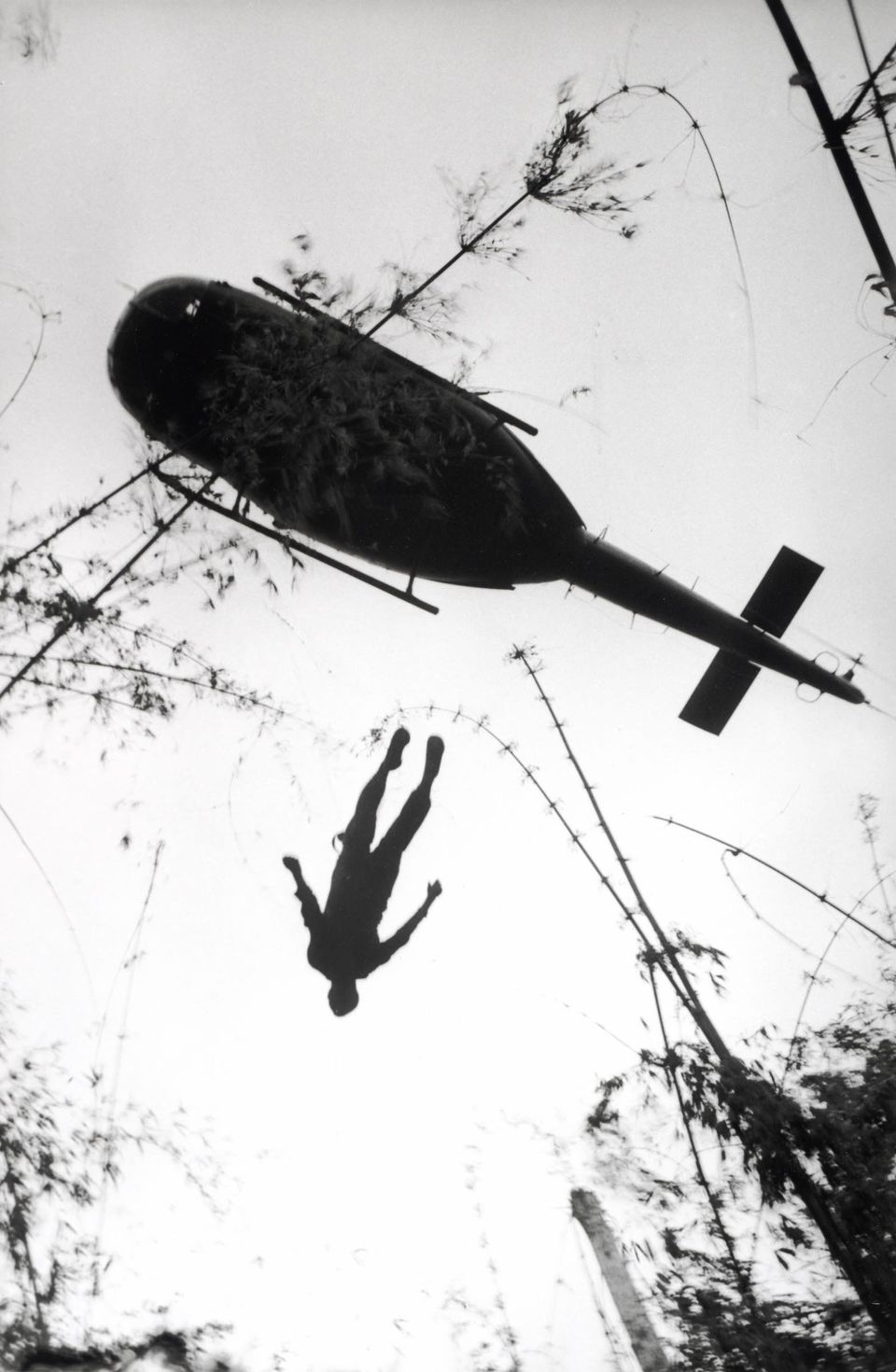 Henri Huet, French (1927-1971), The body of an American paratrooper killed in action in the jungle near the Cambodian border