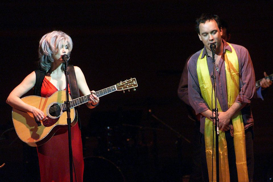 Emmylou Harris and Dave Matthews on stage performing during the Tibet House Benefit Concert 2001 with artistic director Phili