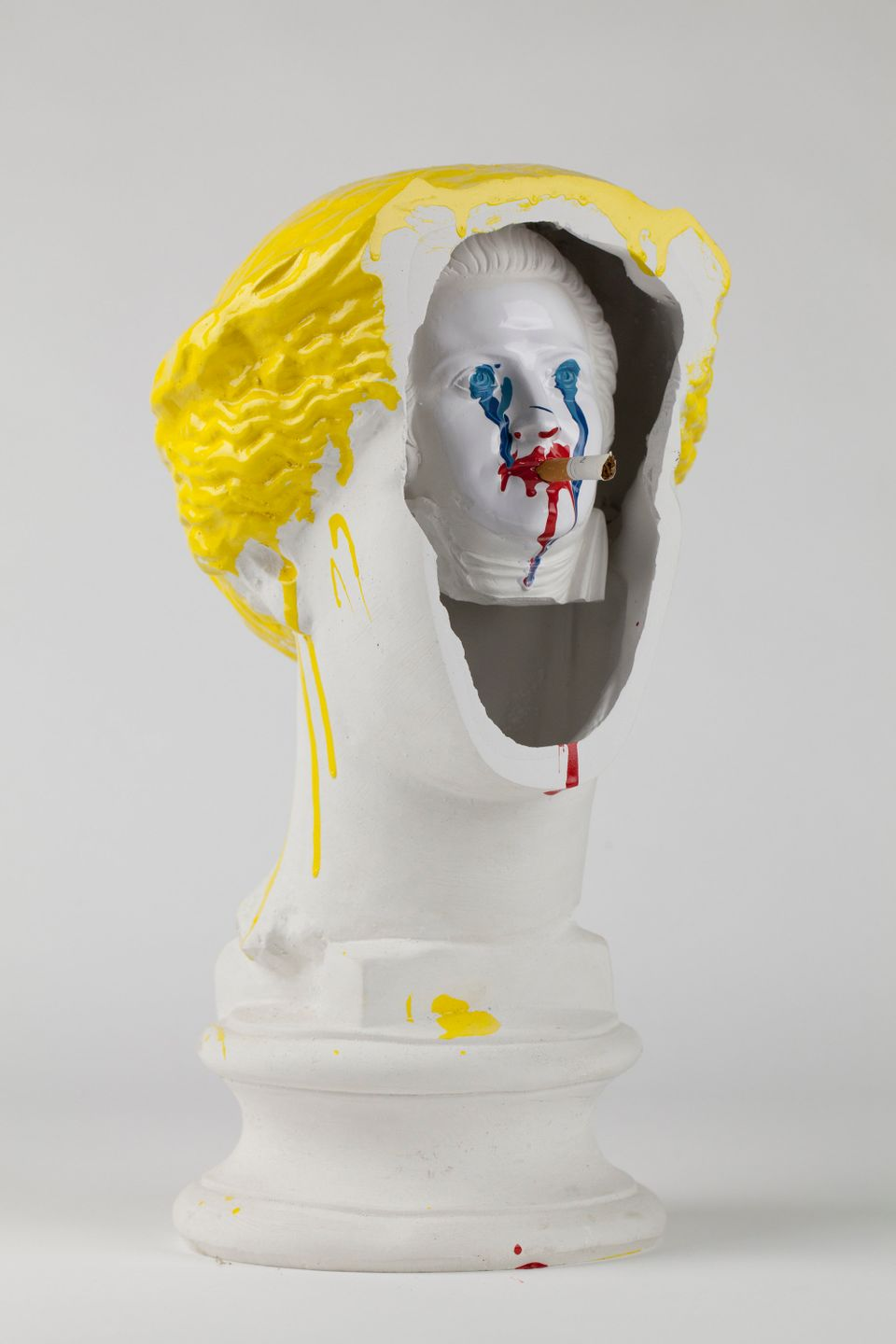 The Bruce High Quality Foundation Self Portrait (Behind the Eyes), 2012 Plaster bust, enamel paint, cigarette butt 151/4 x 7